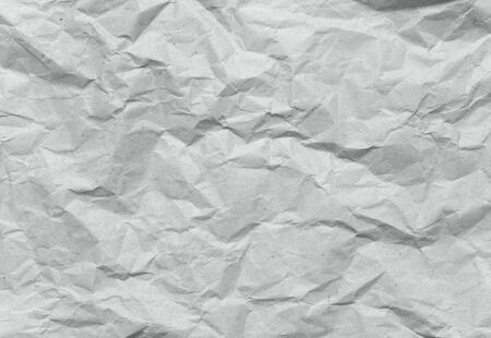 Crumpled gray recycled rough packing paper texture background 写真素材