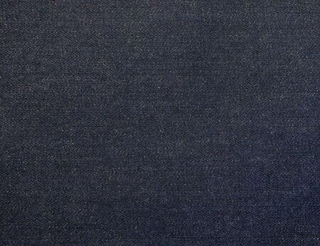 Textuurstaal van donker indigo gewassen denimstof Stockfoto