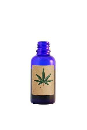 Cannabidiol oil in the dark blue glass bottle isolated on white. Ð¡annabis leaf on the paper label.