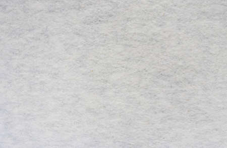 Fluffy knitted cotton polyester fabric texture. Heather gray sweater hoody wrong side swatch