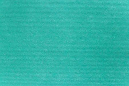 Turquoise green tinted paper texture closeup. Horizontal straped sheet. 写真素材
