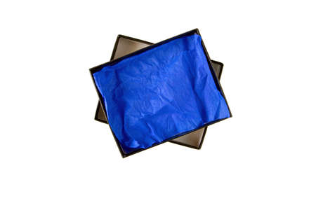 Opened black flat rectangular cardboard box with blue crumpled wrapping paper top view isolated on white