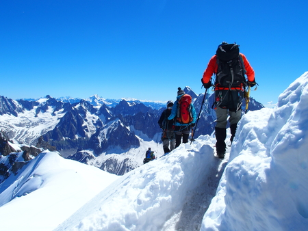 Four alpinists and mountaineer climber on Aiguille du Midi Stock Photo