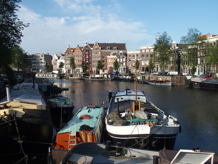 lading: Boats at canal in Amsterdam, The Netherlands