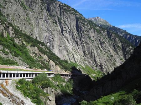 Scenic stony road tunnel in swiss Alps in SWITZERLAND