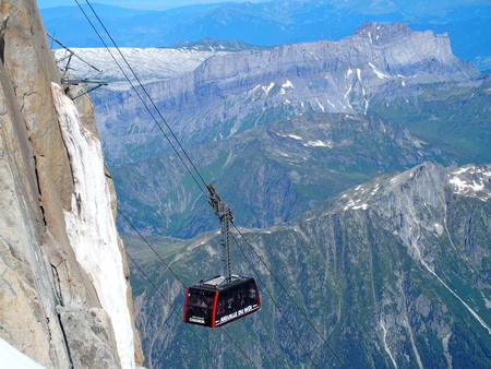 Cable car cabin on AIGUILLE DU MIDI in highest french alpine mountains range Editorial