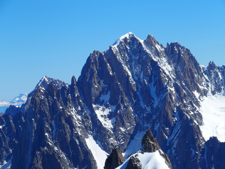 Alpine mountains range landscapes in beauty French, Italian and Swiss ALPS seen from Aiguille du Midi at CHAMONIX MONT BLANC in FRANCE with clear blue sky in 2016 warm sunny summer day, Europe on July.