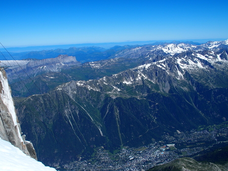 Alpine mountains range landscapes in beauty French, Italian and Swiss ALPS seen from Aiguille du Midi at CHAMONIX MONT BLANC in FRANCE with clear blue sky in 2016 warm sunny summer day, Europe on July Stock Photo