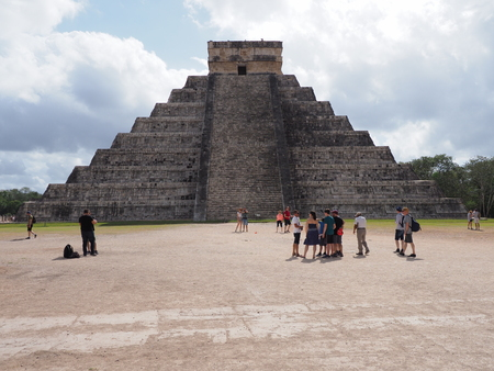 Pyramid and tourists in Chichen Itza mayan town in Mexico, ruins at archaeological site Editorial
