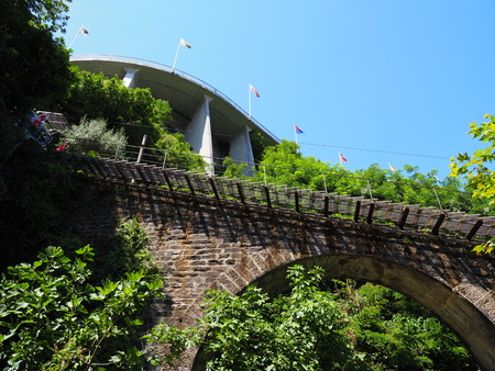 Funicular railway on stony bridge in european city of Locarno in Switzerland above lake Maggiore in canton Ticino with clear blue sky in 2017 warm sunny summer day on July.