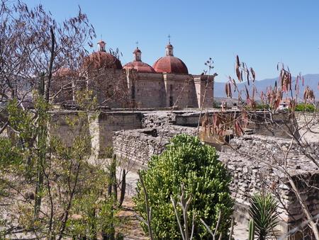 Church of San Pedro in Mitla city important archeological site of Zapotec culture in Oaxaca state in Mexico landscapes, clear blue sky in 2018 warm sunny winter day, North America on February.