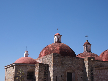 Part of San Pedro church in Mitla city important archeological site of Zapotec culture in Oaxaca state in Mexico landscapes, clear blue sky in 2018 warm sunny winter day, North America on February