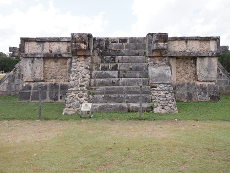 Scenic ancient platform of Eagles and Jaguars building at Chichen Itza city in Mexico, most impressive of archaeological sites in country, cloudy sky in 2018 warm winter day, North America on February