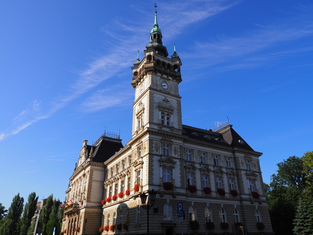View of historical town hall building in european city center of BIELSKO-BIALA in Poland seen from parking with clear blue sky in 2017 warm sunny summer morning day on August.