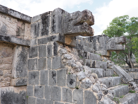 Focus on ancient ruins of Eagles and Jaguars building at Chichen Itza city in Mexico, most impressive of archaeological sites in country, cloudy sky in 2018 warm winter day, North America on February