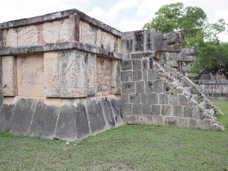Ancient fragment of ruins of Eagles and Jaguars building at Chichen Itza city in Mexico most impressive of archaeological sites in country, cloudy sky in 2018 warm winter day North America on February