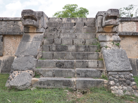 Stairs of ancient ruins of Eagles and Jaguars building at Chichen Itza city in Mexico, most impressive of archaeological sites in country, cloudy sky in 2018 warm winter day, North America on February
