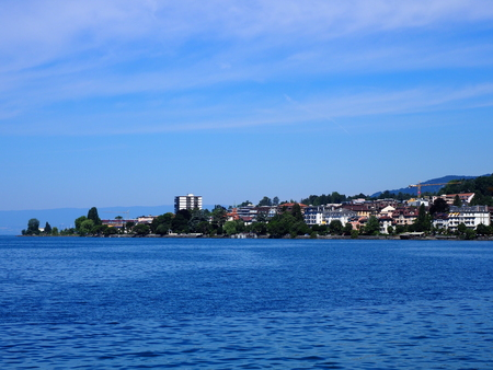 Awesome view of european Montreux city, Switzerland with buildings at Lake Geneva landscapes, swiss promenade in at alpine riviera in Vaud canton, clear blue sky in 2017 warm sunny summer day on July