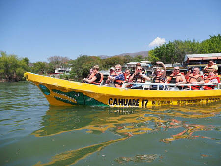 Yellow motor boat with group of tourists on Grijalva river landscape at Sumidero canyon of Chiapas State in Mexico Redakční