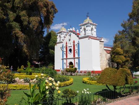SANTA MARIA del TULE, NORTH AMERICA MEXICO on FEBRUARY 2018: Santa Maria de la Asuncion church and Montezuma cypress tree at mexican city at state of Oaxaca, clear blue sky in warm sunny winter day Editorial