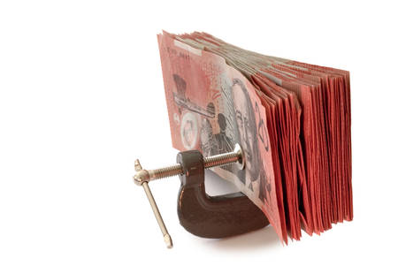 australian banknotes in a g-clamp, metaphor for restriction on spending Stock Photo