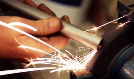 sparks flying from a grinding wheel Stock Photo