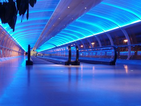 airport walkway tunnel with blue lights, manchester airport Stock Photo