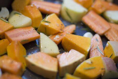 seasoned: a tray of seasoned winter vegetables ready for roasting