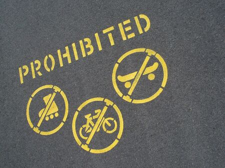 no cycling and skating sign stencilled on a pavement Stock Photo - 3759329