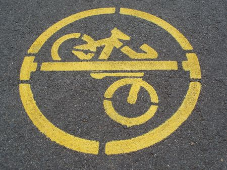no cycling sign stencilled on a pavement photo