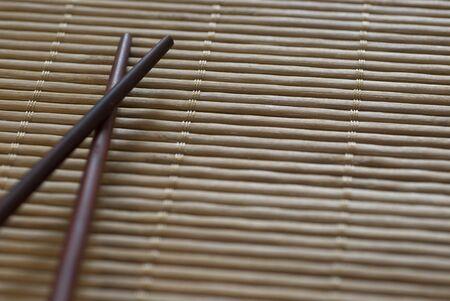 Chopsticks on a bamboo roll placemat