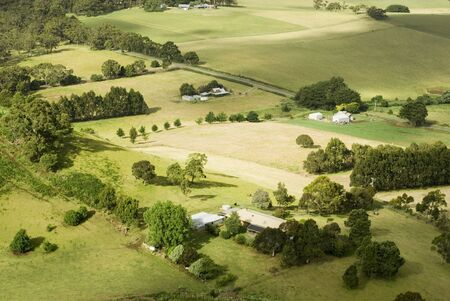 View from above of a patchwork of fields and small farmsteads, Victoria, Australia Stock Photo