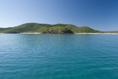A lone yacht moored off great keppel island, queensland, australia Stock Photo