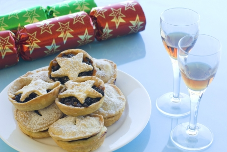 a Christmas still life with mince pies, glasses of sherry and crackers Stock Photo