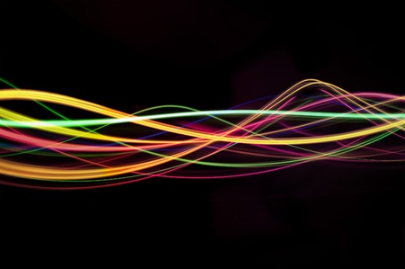 abstract sinusoidal waves of light on a black background Stock Photo