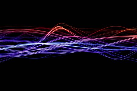 Red, blue and purple waveforms of light on a black background Stock Photo