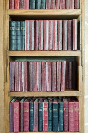 a shelf stacked with leather bound prayer books Stock Photo