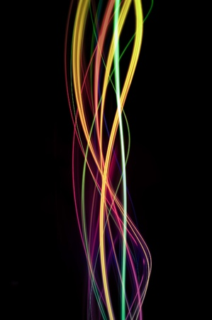 background of colourful twisting lines of color on black