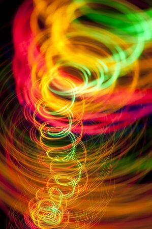 vividly: a spiral of vividly coloured lines of light on a black background
