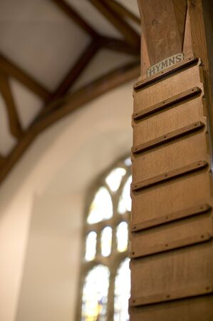 hymn: blank wooden hymn board in a gothic style church