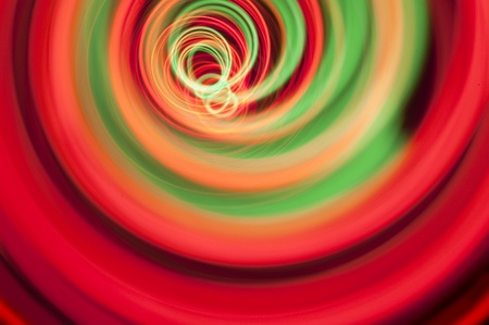 vividly: vividly colored red and green spiral of light created in camera