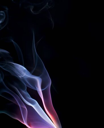 colorful purple and blue lit smoke on a black background