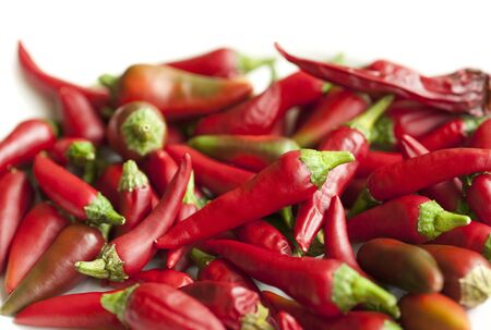 An abstract background of lots of whole red chillies