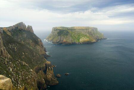 steep cliffs: Tasman Island standing of the steep cliffs of Cape Pillar, Tasmanian coast, Australia Stock Photo