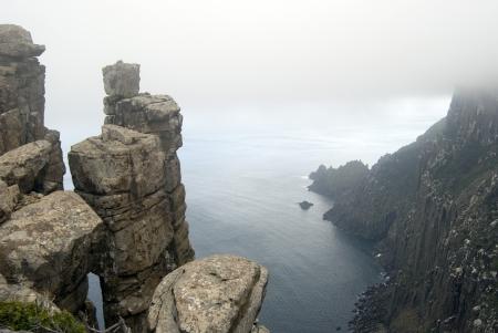 Precarious stacks of dolerite form the rugged cliffs of Cape Pillar, Tasmania Stock Photo - 14772615
