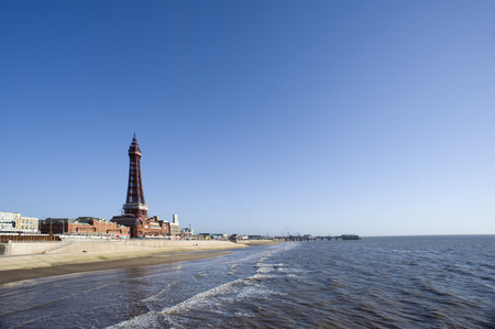 beachfront: View of Blackpool beachfront with the historic Blackpool Tower, a tourist resort in in Lancashire, England, on a sunny blue sky day