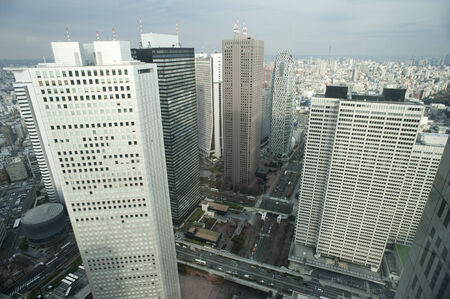 City Overview of Shinjuku, Tokyo, Japan with Skyscrapers and Cloudy Sky