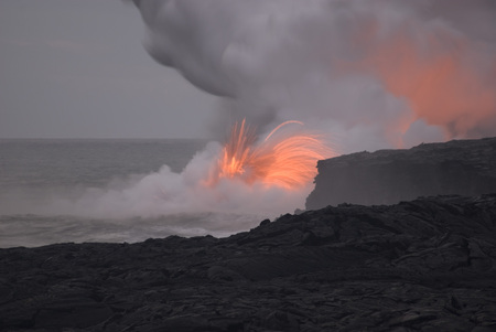 erupt: lava flowing into the sea makes an amazing sight for visitors to hawaiiis big island, Hawaii, USA