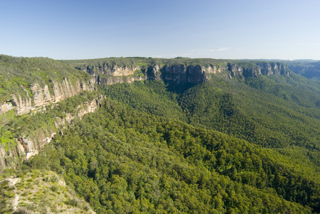 Scenic view of an escarpment in the Blue Mountains, NSW, Australia with forested slopes forming the Grose Valley