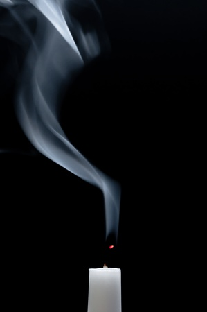 Smoking white candle photo